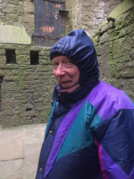 Trying to avoid the wind inside the keep