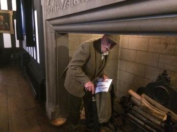 Mr Essoldo checking the fireplace